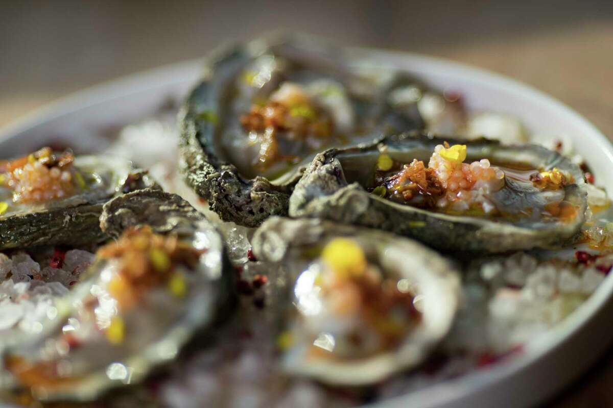 Oysters with chili pearls, Thai basil oil and crispy shallots at Decatur Bar & Pop-Up Factory, 2310 Decatur.