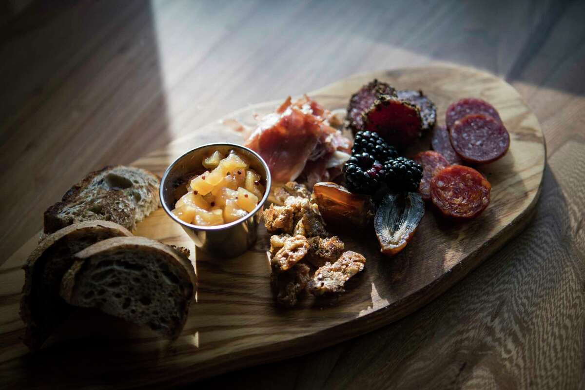 Charcuterie board with three different meats, fruit preserve, house pickles and spiced nuts at Decatur Bar & Pop-Up Factory, 2310 Decatur.