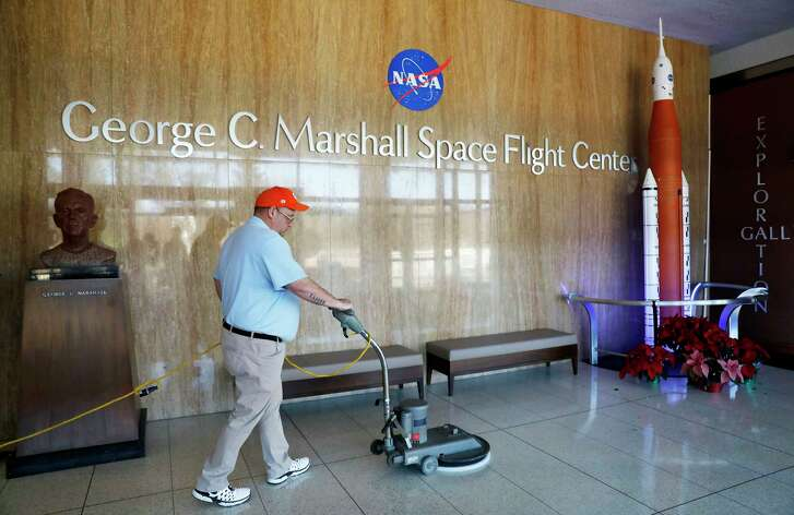 A worker cleans the floors at NASA's Marshall Space Flight Center, which has been impacted by the partial federal government shutdown at the Army's Redstone Arsenal in Huntsville, Ala., Wednesday, Jan. 9, 2019. Located at the base of a mountain in the lush Tennessee Valley, Huntsville was just another Alabama city until the government decided to build rockets at Redstone Arsenal at the dawn of the space race. (AP Photo/David Goldman)