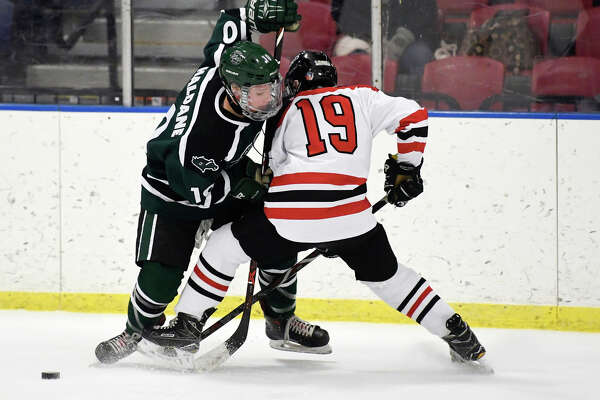 Shenendehowa's Cole Haldane (10) and Albany Academy's William Lenkowitz (19) chase the puck during the first period of a high school hockey game Thursday, Jan. 10, 2019, in Albany, N.Y.