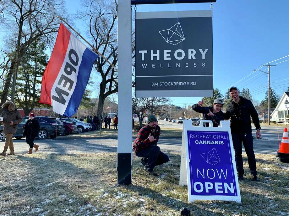 "A cheer rang out from the line as Theory Wellness marijuana store staff brought the ""Now Open"" sign to the roadside in Great Barrington, Mass., on Friday, Jan. 11, 2019. (Bethany Bump/Times Union) Photo: Bethany Bump/Times Union"