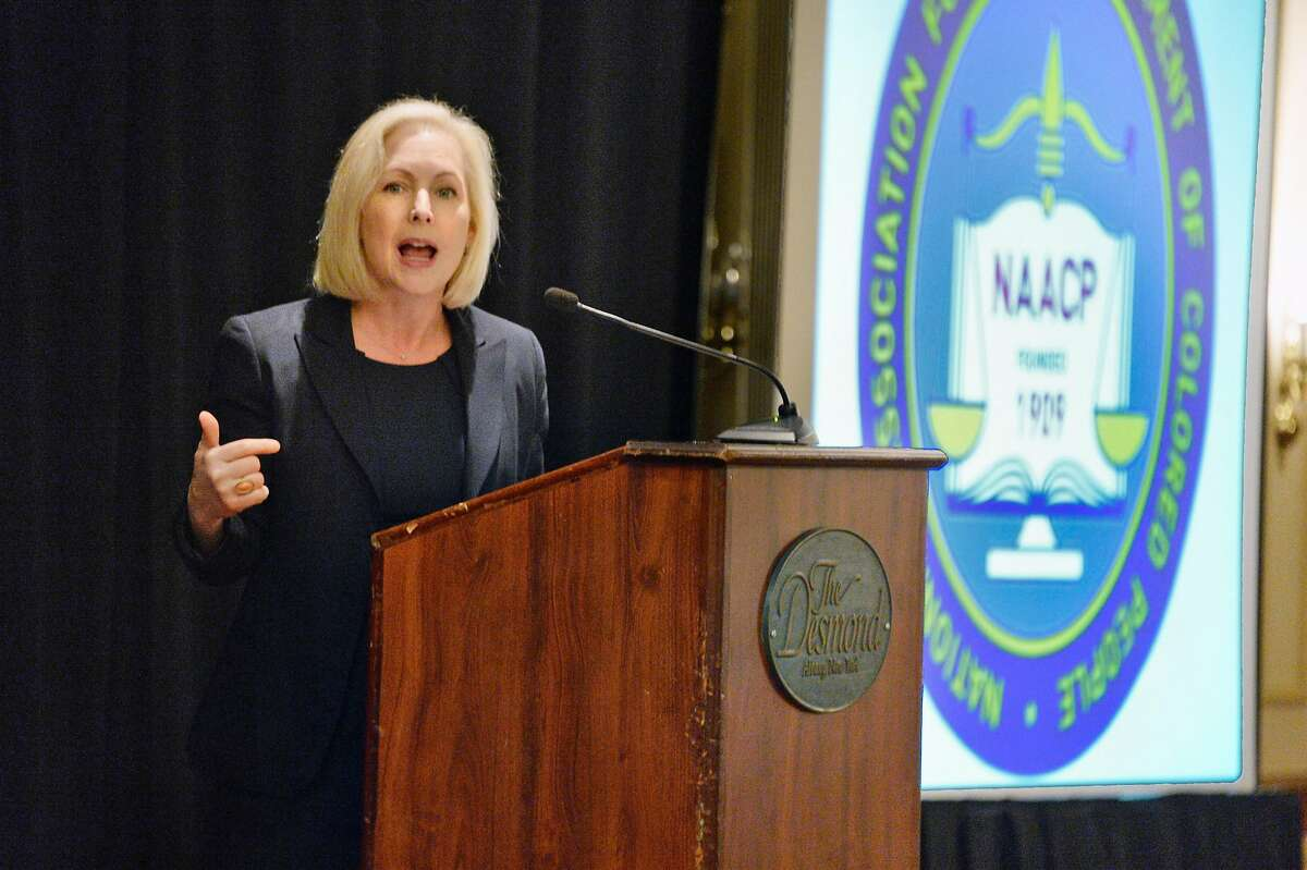 Sen. Kirsten Gillibrand, D-N.Y., addresses an NAACP meeting last year in Colonie, N.Y. She has hired two top communications advisers for the 2020 race.