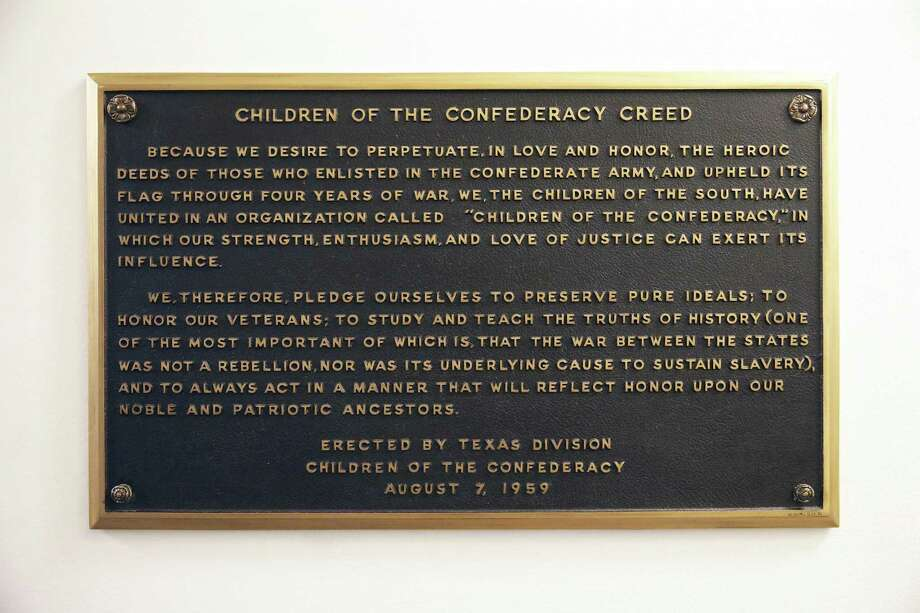 A plaque stating the Children of the Confederacy Creed is positioned in a narrow hallway just outside the main concourse of the Capitol rotunda on August 17, 2017. Photo: Tom Reel, Staff / San Antonio Express-News / 2017 SAN ANTONIO EXPRESS-NEWS