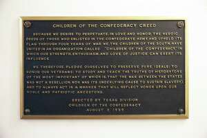 A plaque stating the Children of the Confederacy Creed is positioned in a narrow hallway just outside the main concourse of the Capitol rotunda on August 17, 2017.