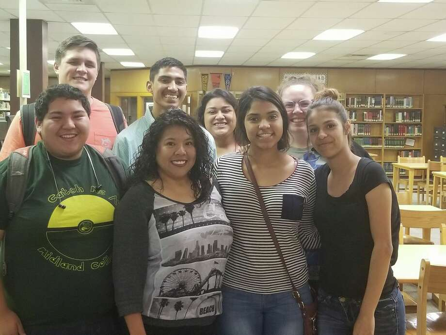 Be the Change founder and executive director Sandra Candia (center left) stand with 2017 graduates of the BTC program at Lee High School. Photo: Courtesy Photo
