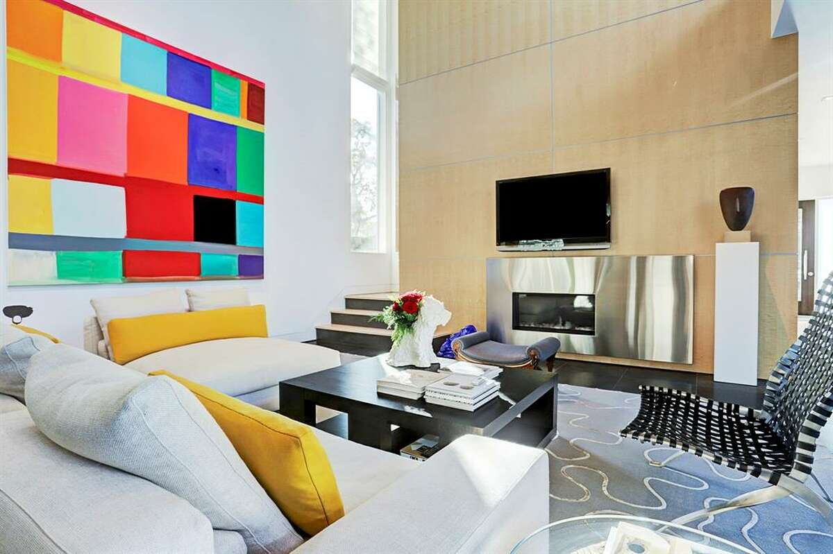 Located at3207 Virginia Street, this modern, highly customized Upper Kirby home stands out with beautiful pops of color throughout the estate. The 5,329 square-foot property boasts four bedrooms, 4 and a half bathrooms, salt water pool, gym, basketball court and a rose garden. Photo courtesy HAR/TK Images