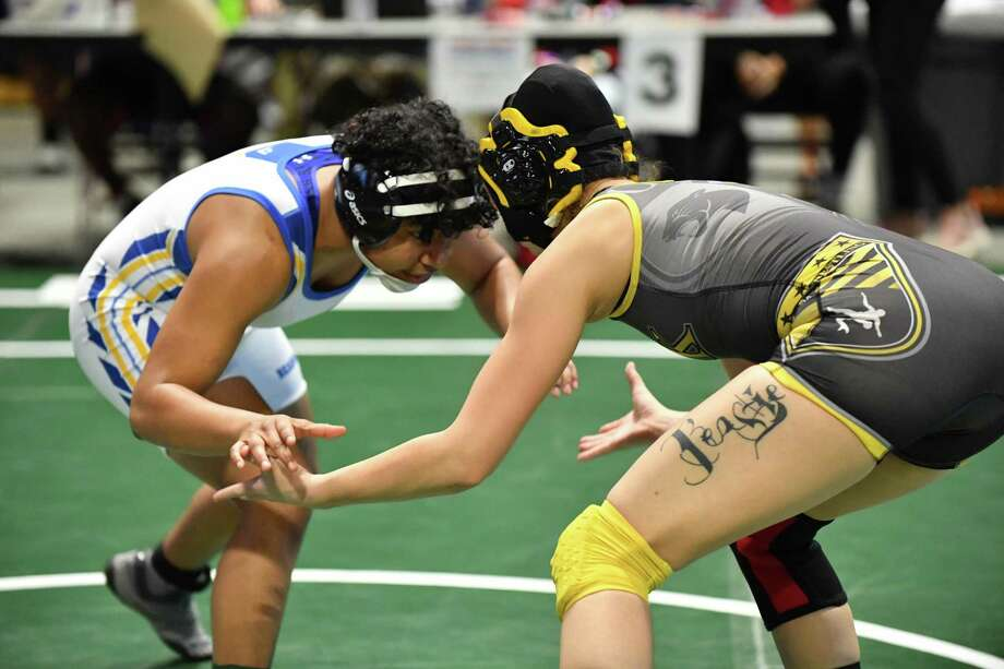 Xochitl Mota-Pettis (left) of Klein faces Brianna Jones of Klein Oak in the 128-pound championship match at the 17th annual CFISD Invitational on Jan. 5 at the Berry Center. Mota-Pettis placed first in her weight class and is ranked No. 1 nationally at 127 pounds. Photo: Wrestling Texas