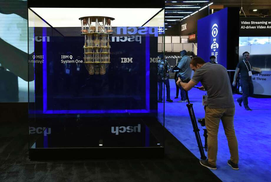 An attendee photographs IBM's quantum computing display at the IBM booth at CES 2019 in Las Vegas. CES is the world's largest annual consumer technology trade show. Photo: David Becker, Stringer / Getty Images / 2019 Getty Images