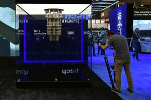 An attendee photographs IBM's quantum computing display at the IBM booth at CES 2019 in Las Vegas. CES is the world's largest annual consumer technology trade show.