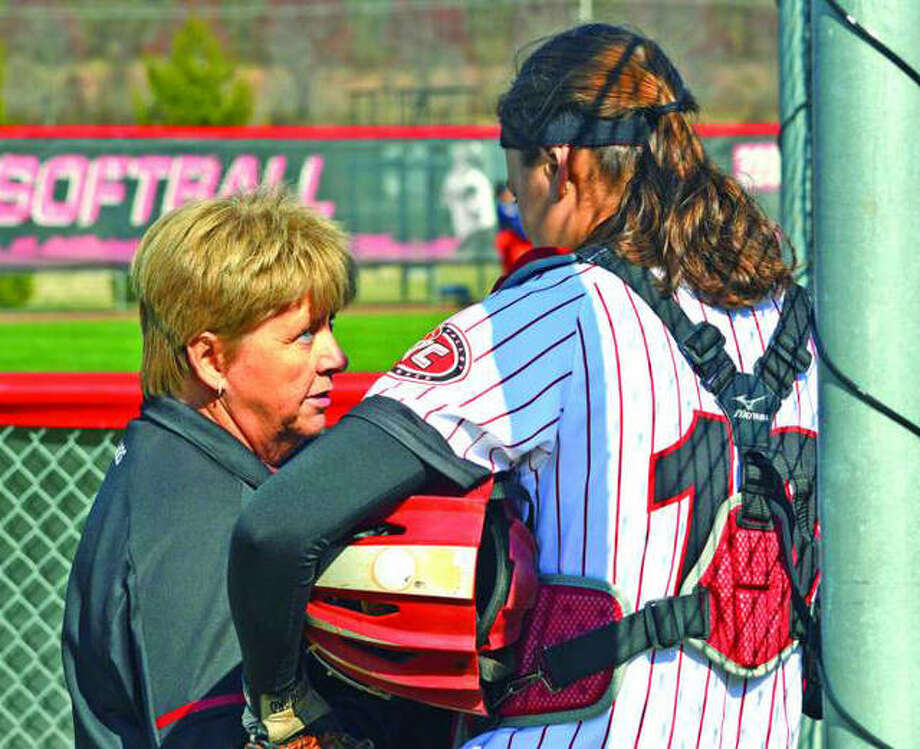 Former SIUE softball coach Sandy Montgomery (left) talks to catcher Sydney Bina during a regular season game in her final season in charge of the Cougars. Photo: Scott Marion/Intelligencer