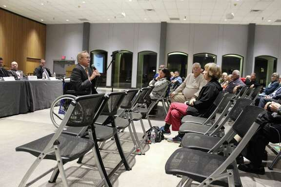 Mayor Pat Hallisey speaks to residents at a Jan. 10 town hall meeting about the need to address major drainage issues after Hurricane Harvey.