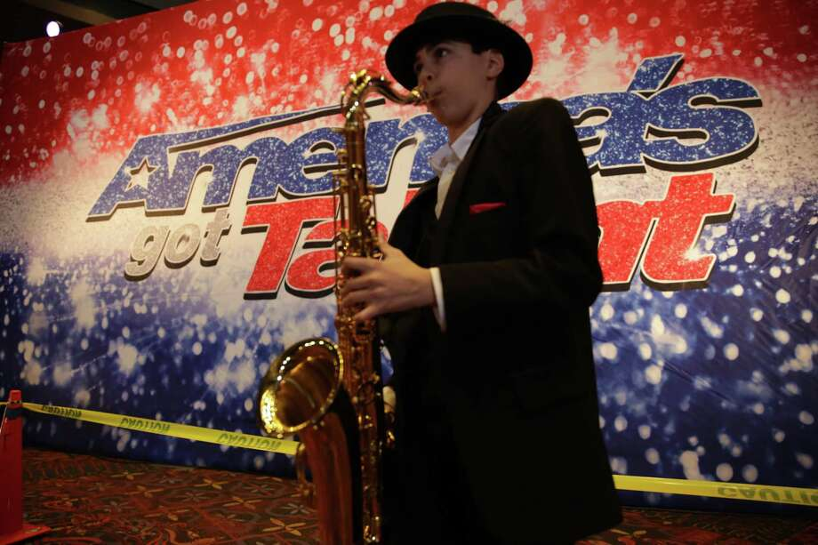 Nico Colucci, 14, from Colorado Springs, practices before his audition. Almost 200 countries around the world have their own version of the TV talent show. Photo: Bob Owen /Staff / San Antonio Express-News