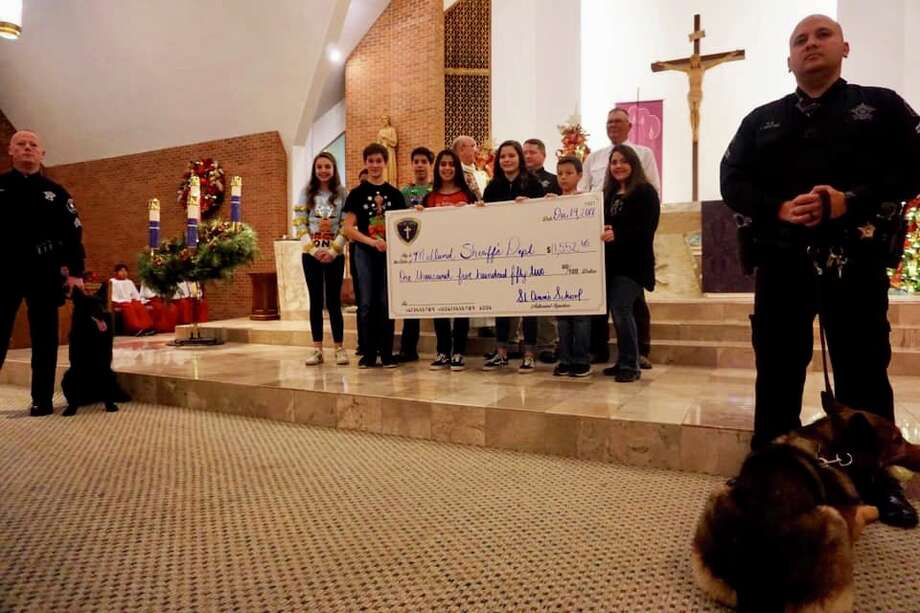 St. Ann's Catholic School raised $1,552.65 after students learned that K-9 Edy was going to be retired and the sheriff's office was raising funds for his replacement.  Photo: Courtesy Photo