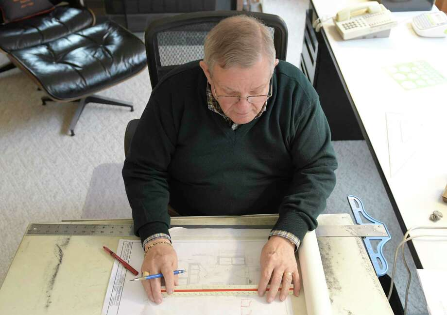 Burlingame Interiors owner Fred Hershey works out a sketch in his home office Thursday, Jan. 3, 2019, in Loudonville, N.Y. (Phoebe Sheehan/Times Union) Photo: Phoebe Sheehan