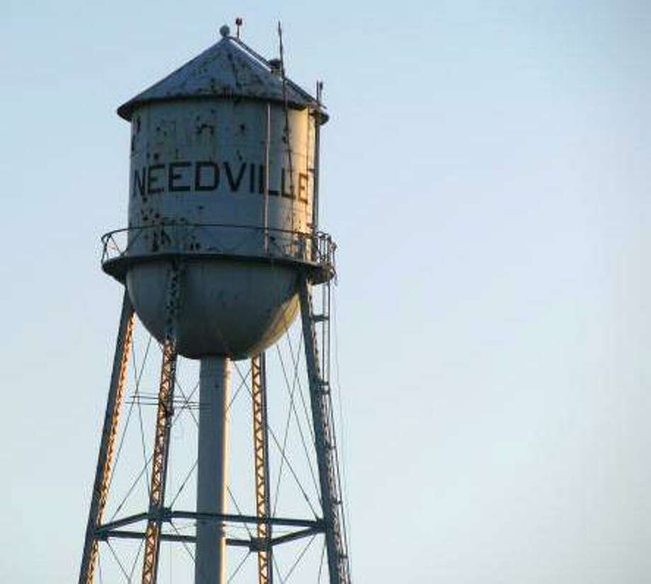 The World War II-era water tower in Needville will stand, for now, as opposing groups will head to court to learn the structure's future in an October 2019 trial in Fort Bend County. Photo: File Photo