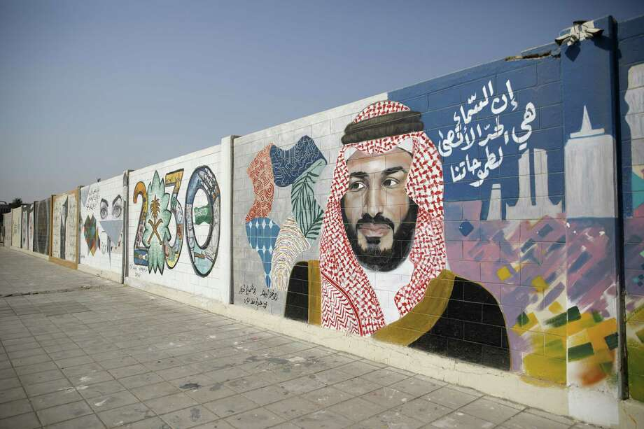 A wall mural displays the '2030 Vision' logo and Saudi Arabia's Crown Prince Mohammed bin Salman in Dhahran, Saudi Arabia, onOct. 4, 2018. Photo: Bloomberg Photo By Simon Dawson / Bloomberg