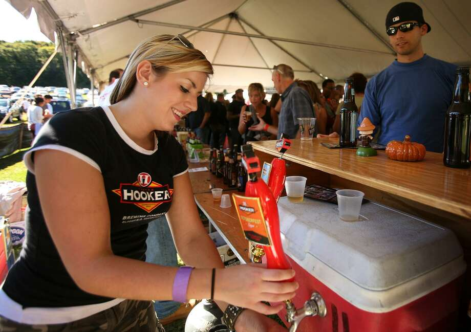 Kate Pasternak, of Avon, pours Oktoberfest beer from Bloomfield's Thomas Hooker Brewery at the first Hoptoberfest at Warsaw Park in Ansonia. Photo: Brian A. Pounds / File Photo / Connecticut Post