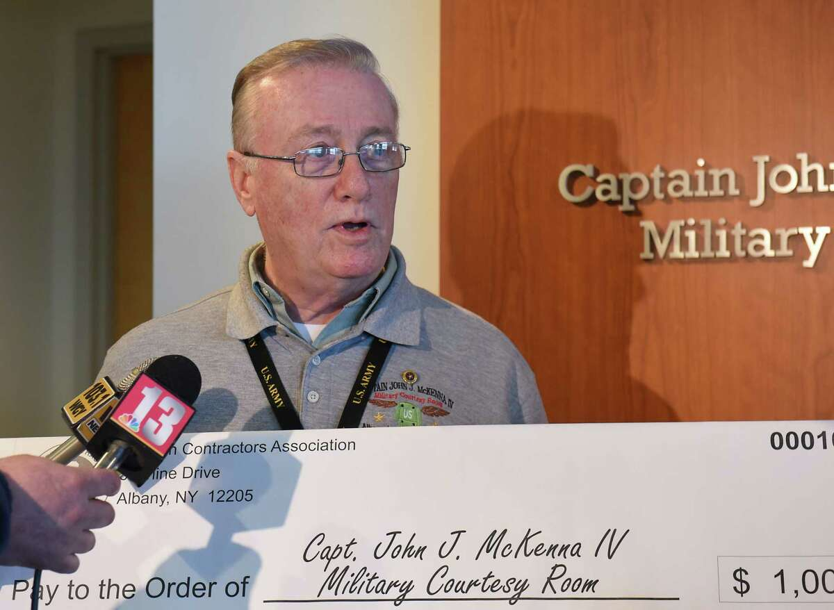 John J. McKenna, III receives a contribution of $1,000 from Todd Helfrich, President and CEO of The Eastern Contractors Association, for the John J. McKenna IV Military Courtesy Room at the Albany International Airport on Friday, Jan. 11, 2019 in Colonie, N.Y. John J. McKenna, III is the son of John J. McKenna IV. (Lori Van Buren/Times Union)