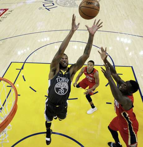 Alfonzo McKinnie (28) goes up for a rebound in the first half as the Golden State Warriors played the New Orleans Pelicans at Oracle Arena in Oakland, Calif., on Wednesday, October 31, 2018. Photo: Carlos Avila Gonzalez / The Chronicle / San Francisco Chronicle/Carlos Avila Gonzalez