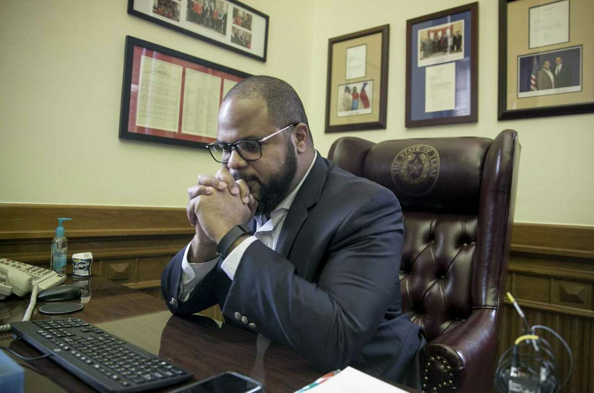 State Rep. Eric Johnson, D-Dallas, has a moment of reflection in his office at the State Capitol in Austin, moments after the State Preservation Board voted to remove the Children of the Confederacy Creed from the Capitol building on Jan. 11, 2019. Johnson pushed for its removal after the 2017 deadly white nationalist rally in Charlottesville, Va.