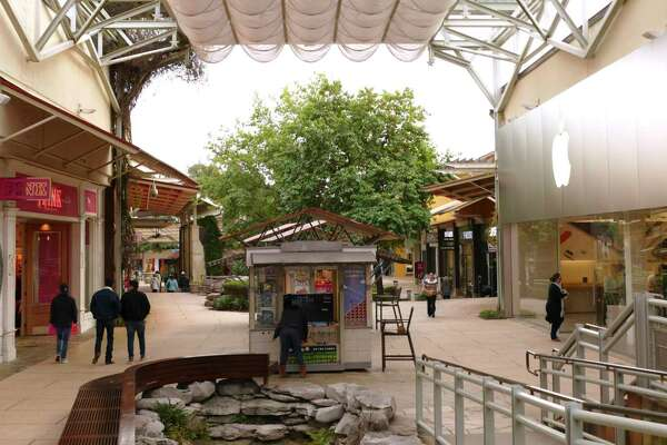 Shoppers stroll at The Shops at La Cantera, before the coronavirus forced most of the stores to close