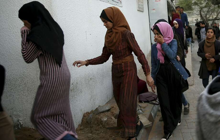 Relatives arrive a Gaza City hospital to see the body of a woman killed by Israeli troops during a protest at the Gaza Strip's border with Israel. Photo: Adel Hana / Associated Press