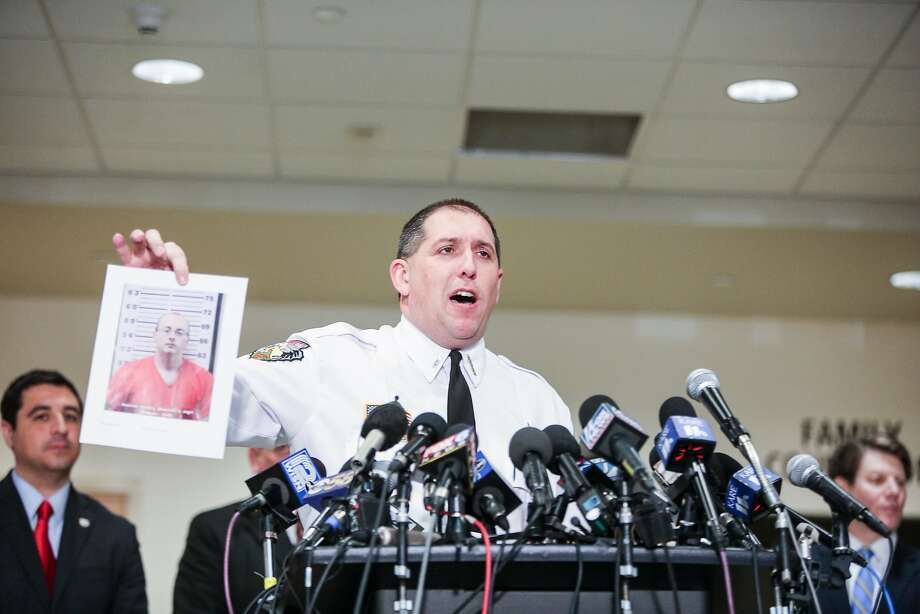 Sheriff Chris Fitzgerald holds a photo of kidnapping suspect Jake Patterson during a news conference in the town of Barron. Photo: Tim Gruber / New York Times