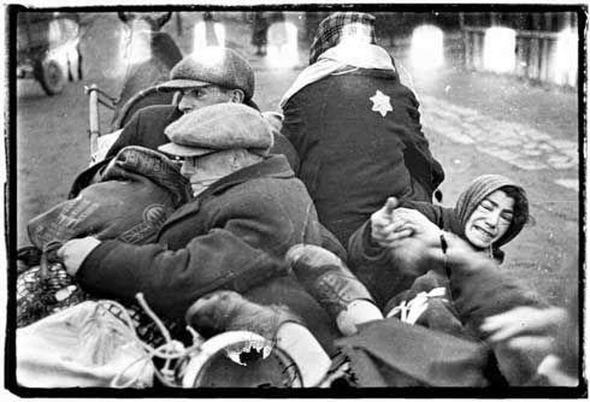 Henryk Ross, a photographer in the Lodz Ghetto, managed to bury the negatives of the thousands of pictures he had taken. He survived in hiding along with 877 other Jewish people in the Lodz ghetto until its liberation by the Russian Army 1944. His pictures are the most comprehensive known collection of Holocaust ghetto photographs by a single Jewish photographer.