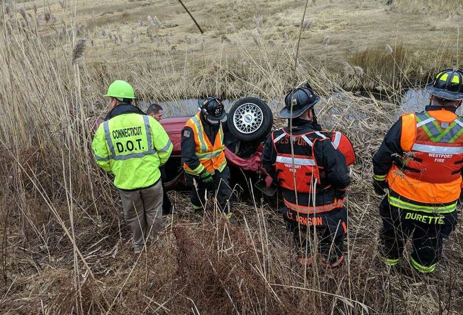 Westport firefighters responded to a report of a car down the emankment and in the water off I-95 on the morning of Jan. 10. Photo: Contributed / Contributed Photo / Westport News contributed