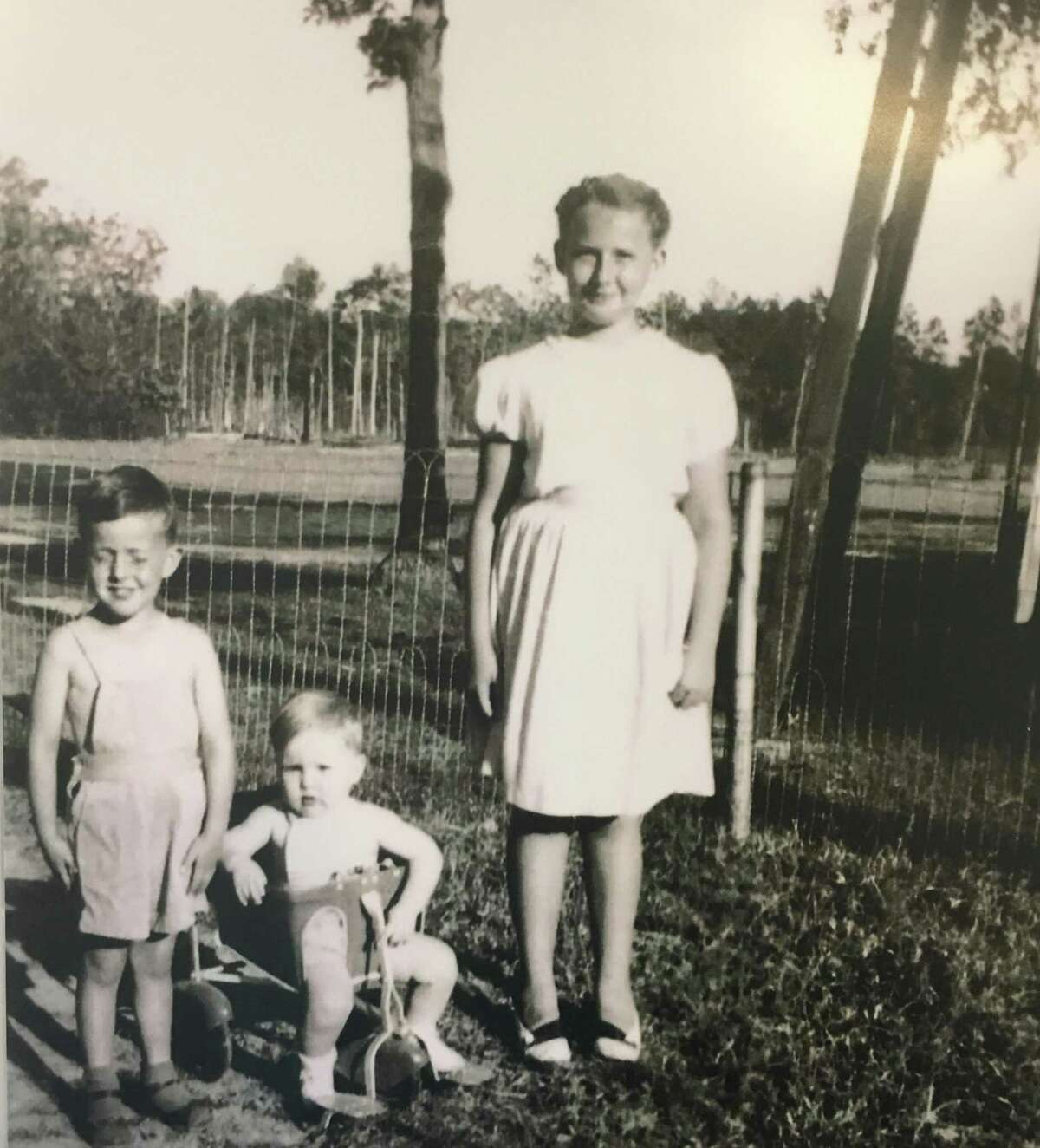 From left, Kelly (Dan), Mike and Mary Lou Houlihan at their home at the Hooper Oil & Gas Lease in the Conroe oilfield.