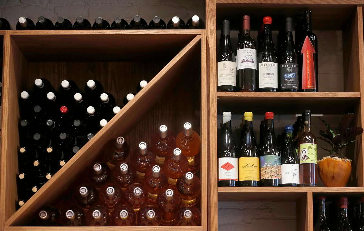 Bottles of wine are displayed before next week's opening of Verjus wine bar and shop on Washington Street in San Francisco, Calif. on Tuesday, Jan. 8, 2019.