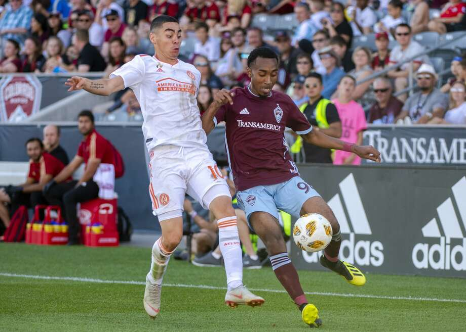 COMMERCE CITY, CO - SEPTEMBER 15: Marlon Hairston #94 of the Colorado Rapids and Miguel Almirón #10 of Atlanta United battle for possession during the second half at Dick's Sporting Goods Park on September 15, 2018 in Commerce City, Colorado. (Photo by Timothy Nwachukwu/Getty Images) Photo: Timothy Nwachukwu/Getty Images