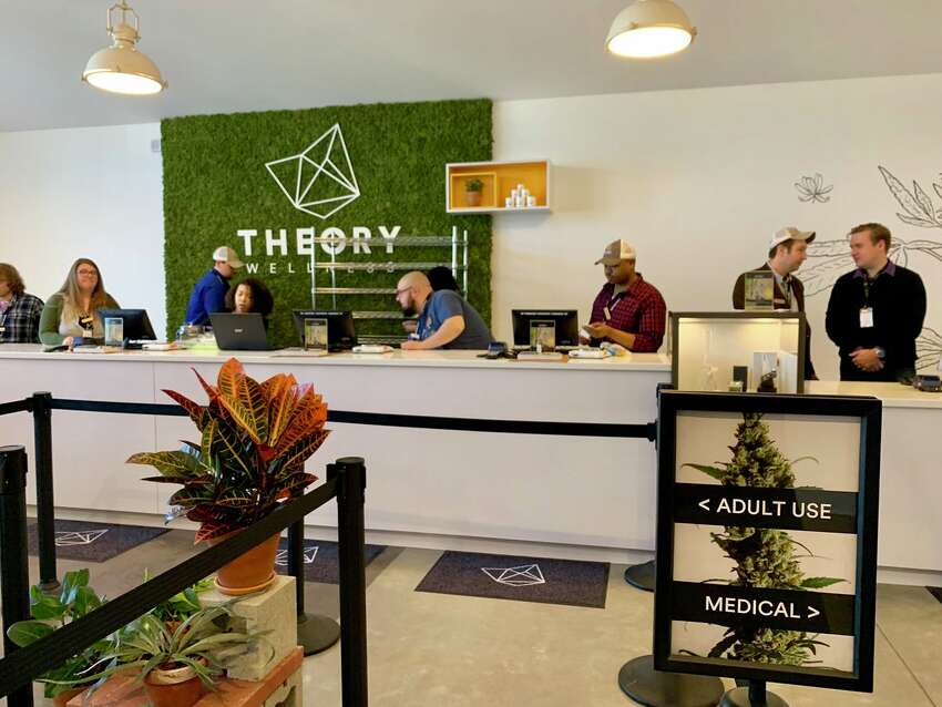 The staff at the Theory Wellness store in Great Barrington, Mass., the first recreational marijuana store to open in the state's Berkshire Mountains region.