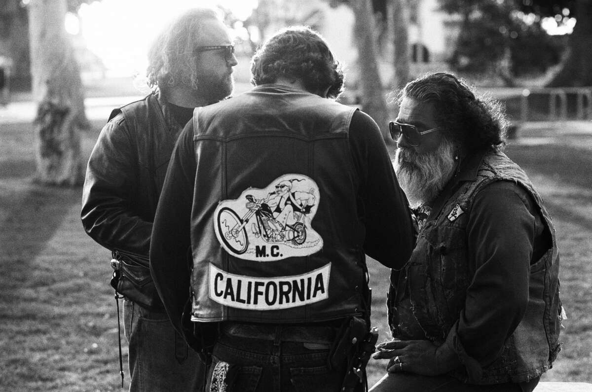 Members of the Long Beach chapter of the Mongols motorcycle club picnic in a park in January 1991 in San Pedro, California.