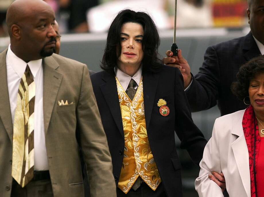 """FILE - In this May 25, 2005 file photo, Michael Jackson arrives at the Santa Barbara County Courthouse for his child molestation trial in Santa Maria, Calif. A documentary film about two boys who accused Michael Jackson of sexual abuse is set to premiere at the Sundance Film Festival. The Sundance Institute announced the addition of """"Leaving Neverland"""" and """"The Brink,"""" a documentary about Steve Bannon, to its 2019 lineup on Wednesday. The Sundance Film Festival kicks off on Jan 24 and runs through Feb. 4. (Aaron Lambert/Santa Maria Times via AP, Pool) Photo: Aaron Lambert, Associated Press"""