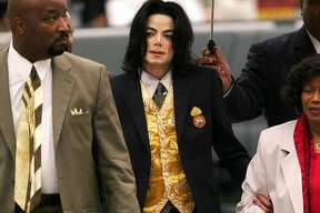 """FILE - In this May 25, 2005 file photo, Michael Jackson arrives at the Santa Barbara County Courthouse for his child molestation trial in Santa Maria, Calif. A documentary film about two boys who accused Michael Jackson of sexual abuse is set to premiere at the Sundance Film Festival later this month. The Sundance Institute announced the addition of """"Leaving Neverland"""" and """"The Brink,"""" a documentary about Steve Bannon, to its 2019 lineup on Wednesday. The Sundance Film Festival kicks off on Jan 24 and runs through Feb. 4. (Aaron Lambert/Santa Maria Times via AP, Pool)"""