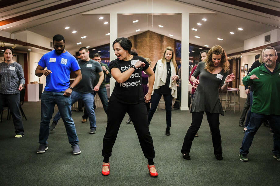 Lucy Pagán, center, teaches basic salsa dance moves during an event for the Midland Young Professionals (MYPros) group on Thursday, Jan. 10, 2019 at Creative 360. (Katy Kildee/kkildee@mdn.net) Photo: (Katy Kildee/kkildee@mdn.net)