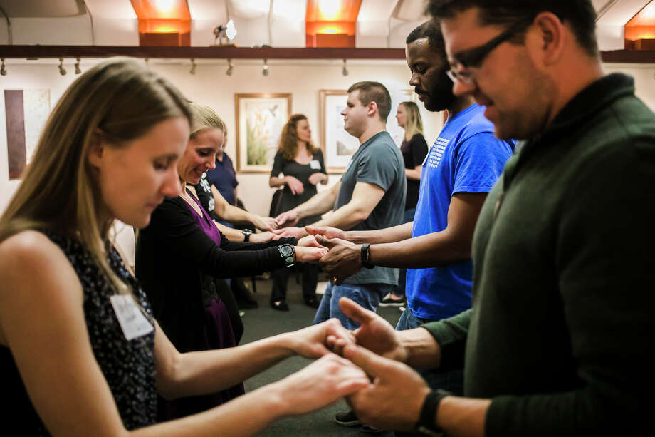 Members of the Midland Young Professionals (MYPros) group learn basic salsa and swing dance moves during an event for the  group on Thursday, Jan. 10, 2019 at Creative 360. (Katy Kildee/kkildee@mdn.net) Photo: (Katy Kildee/kkildee@mdn.net)