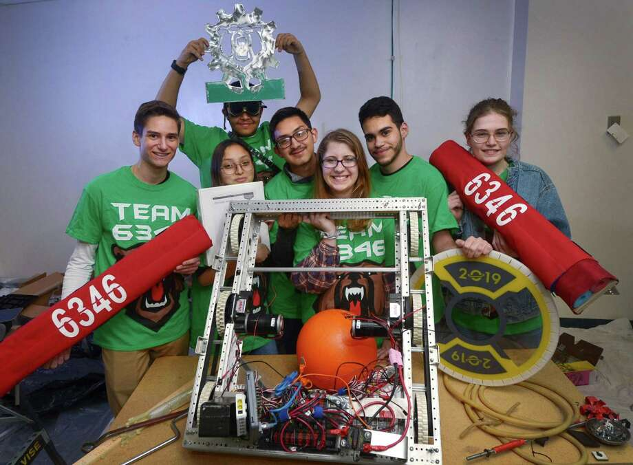 The 6346 Robotics Team including Norwalk High School students, Louis Cundari, Itzel Becerril, Benny Vasquez, Erik Criollo, Julie Turek, Derick Ruiz and Brigitte Arcoite at their new home at 25 Van Zant St. on Wednesday in Norwalk. The team recently lost their work space at the high school. Photo: Erik Trautmann / Hearst Connecticut Media / Norwalk Hour