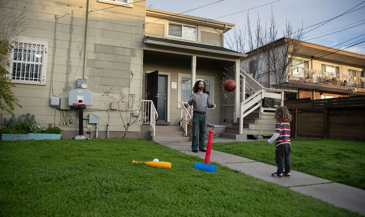 Adam Sandler plays ball with son Baz, 3, in front of their new 2-bedroom duplex on Friday, Jan. 11, 2019, in Berkeley, Calif.