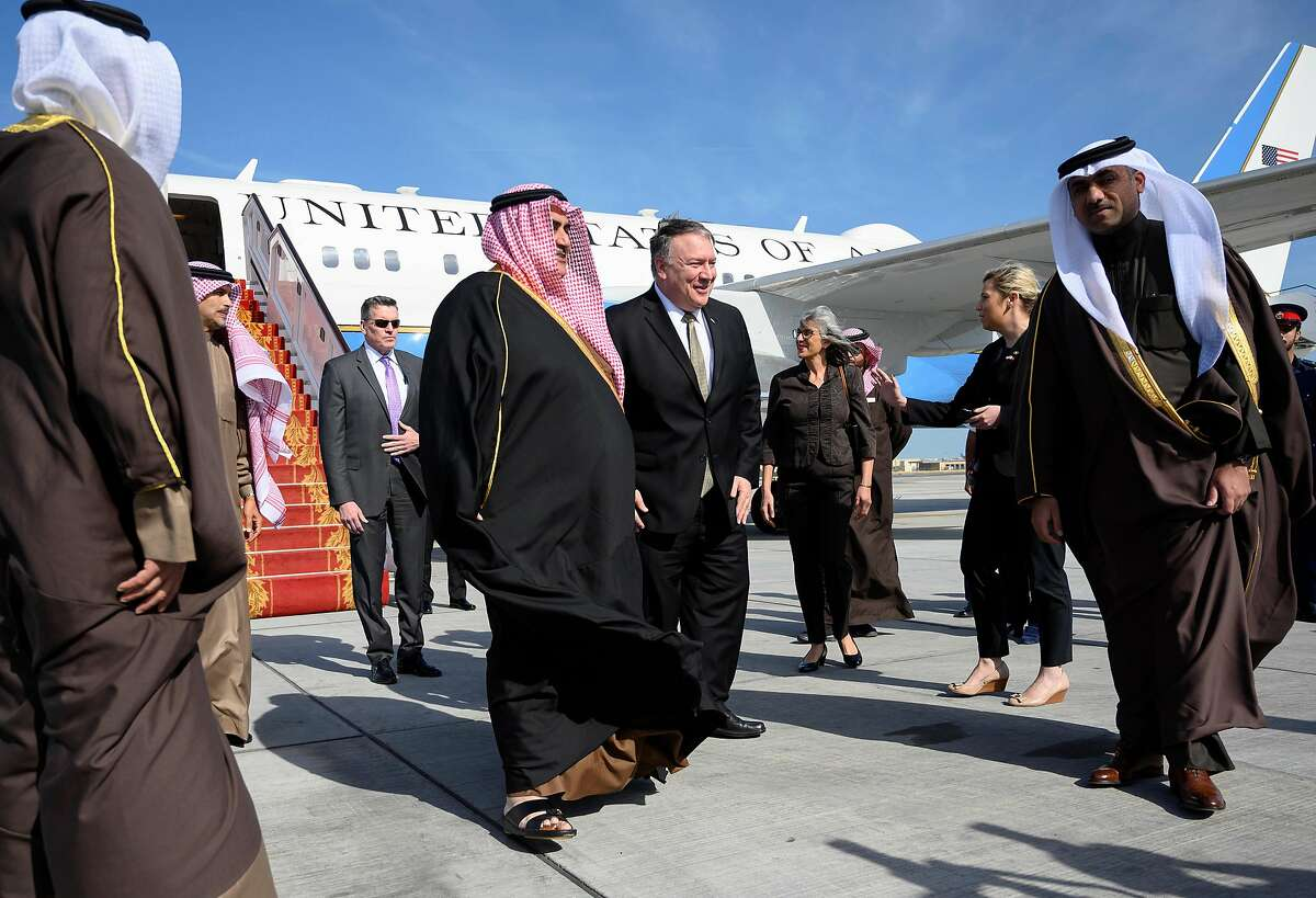 US Secretary of State Mike Pompeo (C-R) is greeted by Bahraini Foreign Minister Khalid bin Ahmed Al Khalifa (C-L) after arriving in Manama International Airport in Manama on January 11, 2019. (Photo by ANDREW CABALLERO-REYNOLDS / POOL / AFP)ANDREW CABALLERO-REYNOLDS/AFP/Getty Images
