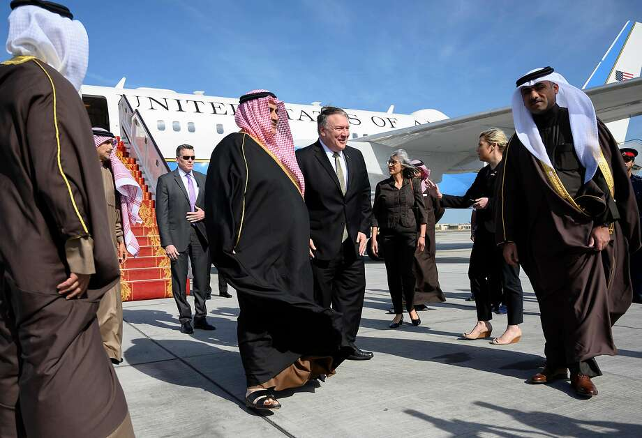 Secretary of State Mike Pompeo (center) is greeted by Bahraini officials upon arrival in Manama. Photo: Andrew Caballero-reynolds / AFP / Getty Images