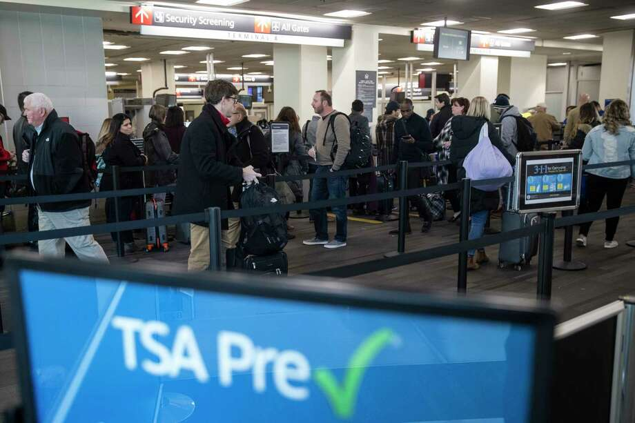 Passengers wait in line at a Transportation Security Administration checkpoint at the Philadelphia International Airport in Philadelphia, Friday, Jan. 11, 2019. Photo: Matt Rourke, AP / Copyright 2019 The Associated Press. All rights reserved.