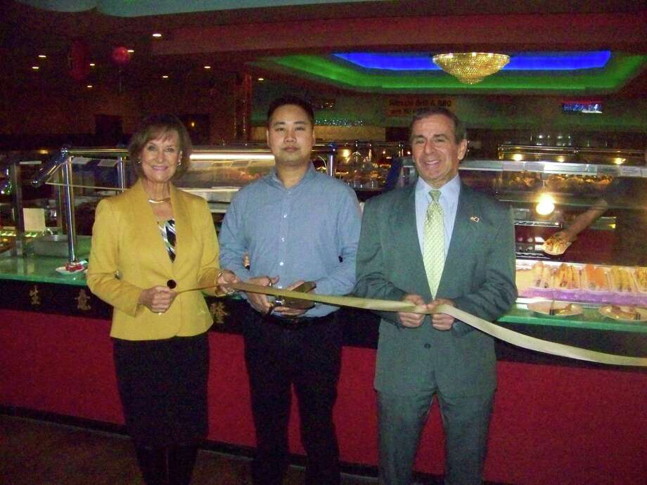 GET COOKING: Han Tang Seafood & Grill Buffet, 61 Washington Ave. in North Haven, recently celebrated its grand opening with a ribbon-cutting ceremony. From left are Dee Prior-Nesti, executive director Quinnipiac Chamber of Commerce; Perry Dong, owner; and North Haven First Selectman Mike Freda. The restaurant offers dining, takeout and delivery of Asian cuisine, including fresh sushi. For information, call 203-889-2450 or visit www.hantangsushiseafoodbuffet.com. Photo: Contributed Photo