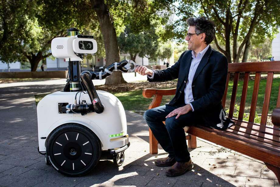 Silvio Savarese, a Stanford computer scientist, sits with a robot called Jackrobbot at the university, in Stanford, Calif., Oct. 5, 2018. Though many have tried to perfect the next version of a home robot, no one has succeeded. The Fourth Industrial Revolution will occur as such problems are surmounted. Photo: DREW KELLY /NYT / NYTNS
