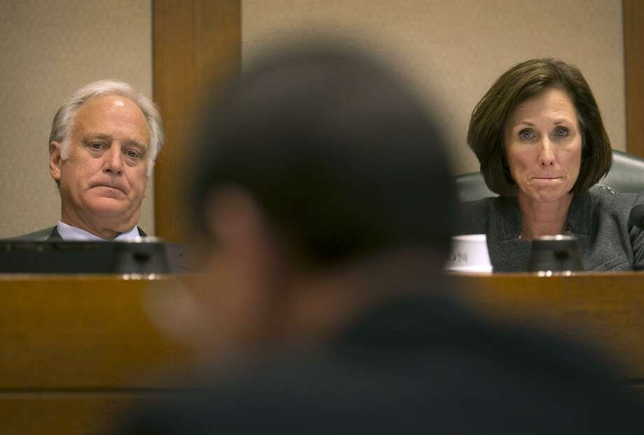 Texas Sens. Kirk Watson, D-Travis, left, and Lois Kolkhorst, R-Washington, listen to Hank Whitman, Commissioner of the Department of Family and Protective Services, as he testifies before the Senate of Texas Committee on Health and Human Services during a hearing at the Texas Capitol Feb. 2, 2017. Children's issues are again front and center in the current Legislature. Photo: Ralph Barrera /Associated Press / Austin American-Statesman