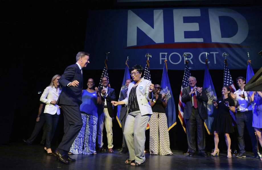 Connecticut gubernatorial candidate Ned Lamont, left, dances with New Haven Mayor Toni Harp as he celebrates his win in the Democratic primary in New Haven in August. Photo: Jessica Hill / Associated Press / AP2018
