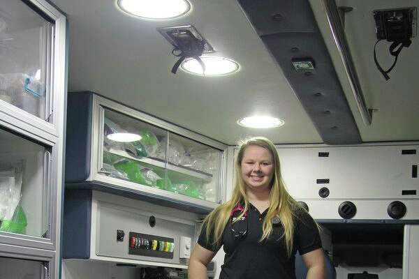 Ubly High School senior McKenzie Stomack stands inside a Central Huron Ambulance rig. She started as an EMT in late December. (Seth Stapleton/Huron Daily Tribune)