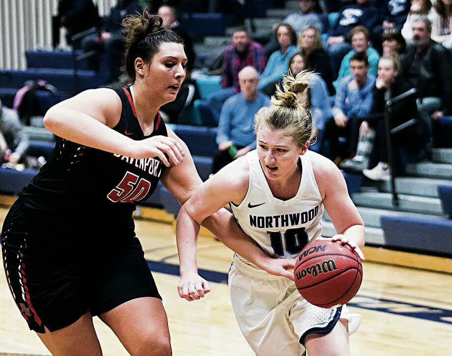 Northwood's Ellie Taylor drives by Davenport's Jenna Falkenberg during Thursday's game at Riepma Arena. Taylor scored a career-high 30 points vs. the Panthers. Photo: Daily News File Photo