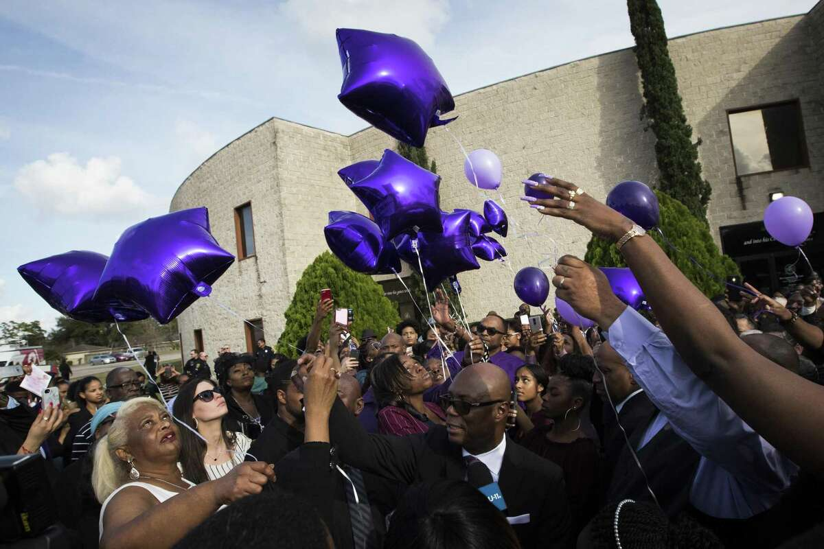 The family of Jazmine Barnes releases balloons at the end of the service in remembrance of her at The Community of Faith Church, Tuesday, Jan. 8, 2019, in Houston.